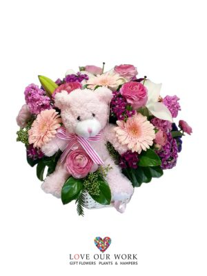 It's a girl! A basket arrangement bursting with floral goodness.