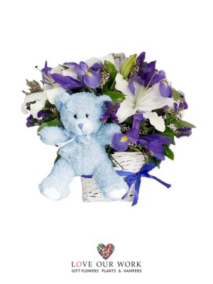 It's a boy! A basket arrangement bursting with blue floral goodness
